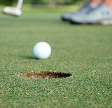 golf ball approaching hole