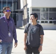 principal and student walking together