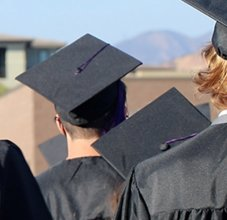 Back of student heads during graduation