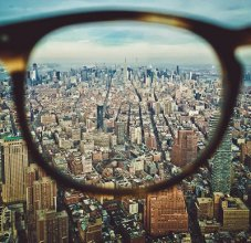 Glasses Lenses Above A City