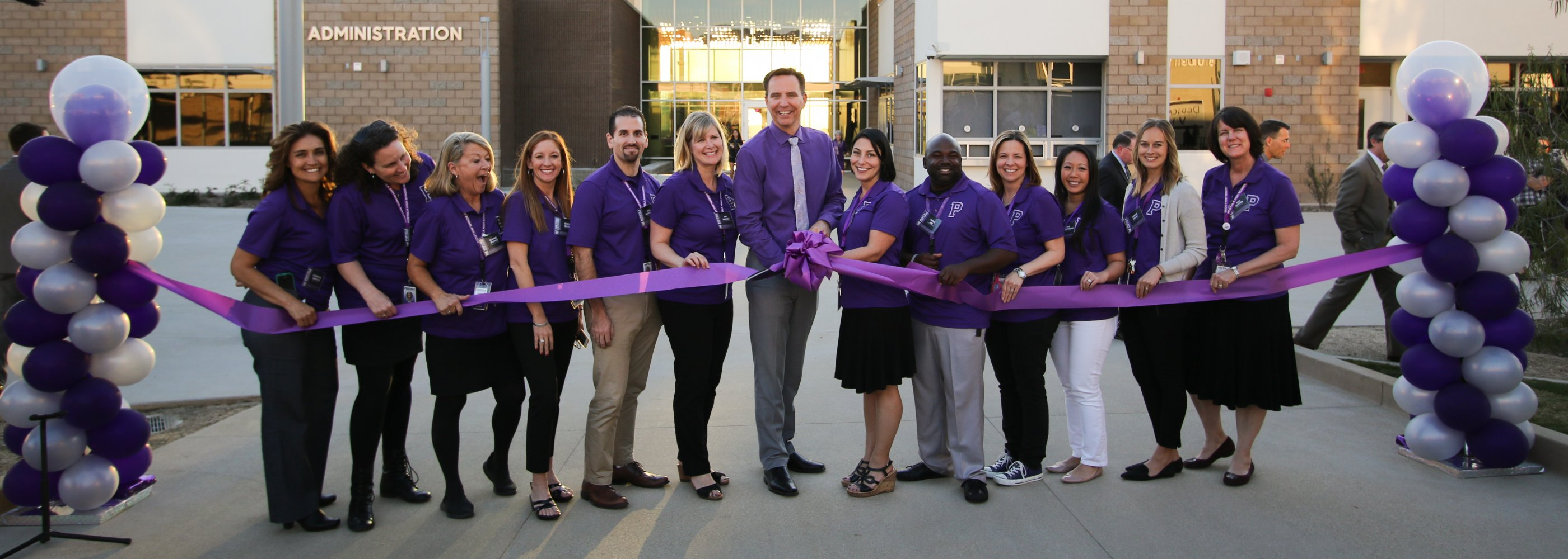 PHS admin staff cutting ribbon